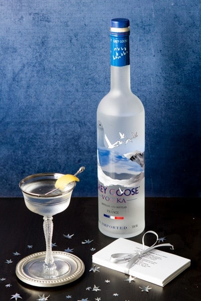Bottle of grey goose vodka, a vodka martini and recipe cards