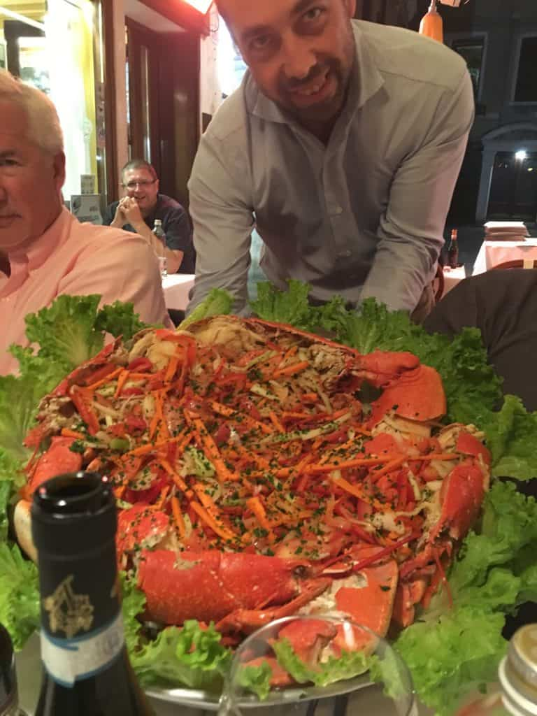 Trattoria Rialto Novo Lobster platter held by the owner