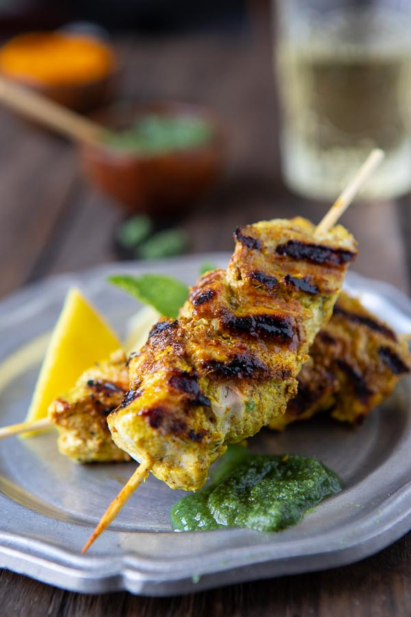 Murgh Tikka or chicken tikka on a plate with mint chutney