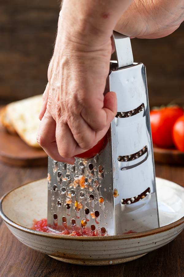 grating tomatoes for pan con tomate.