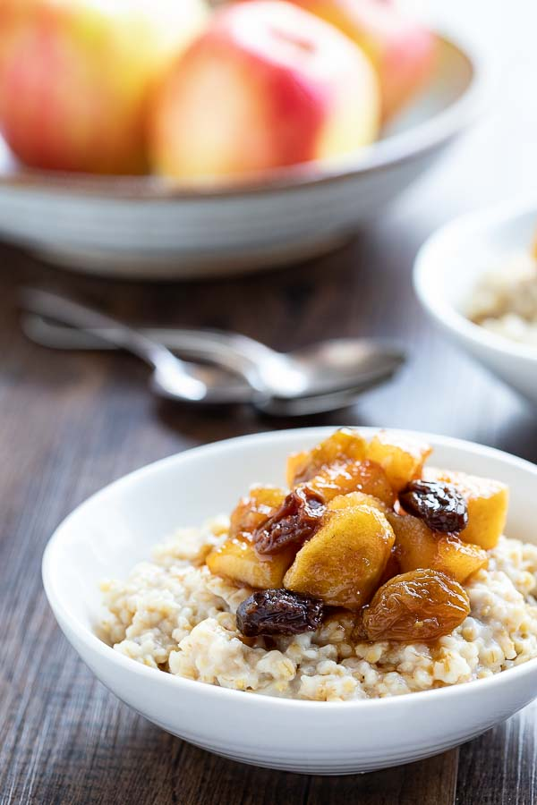 bowl of instant pot steel cut oats with apple compote in a bowl.
