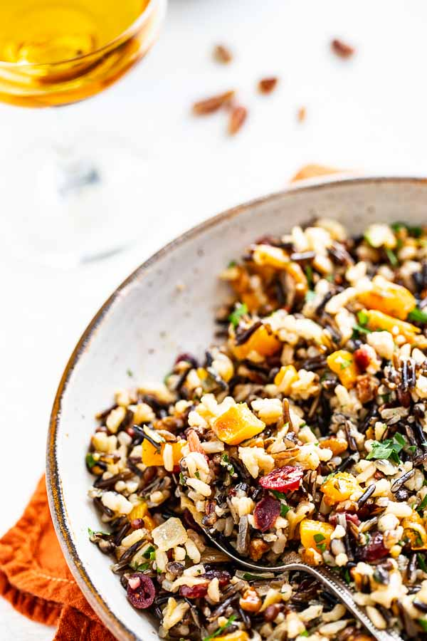 Baked butternut squash and wild rice pilaf in a bowl.