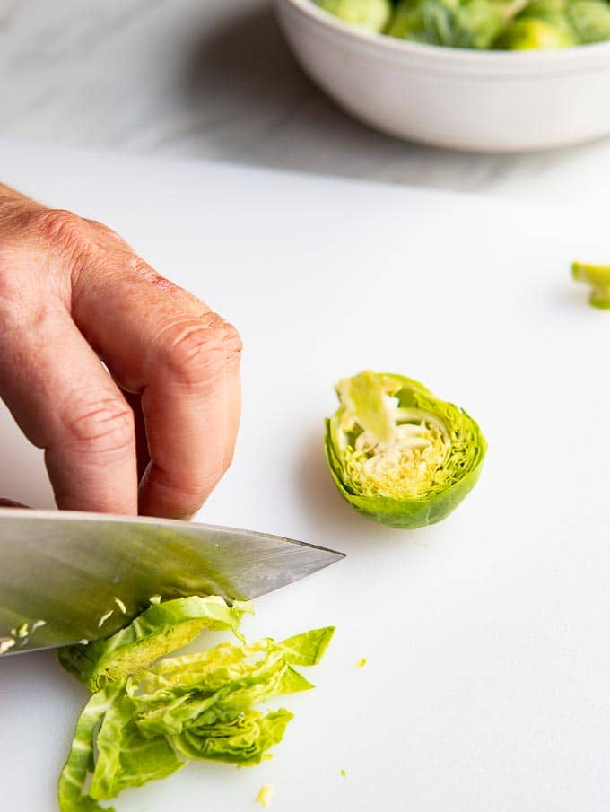 cutting brussels sprouts into thin slices.