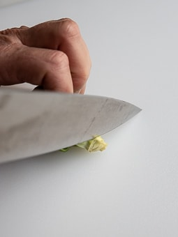 Cutting the stem end off a brussels sprouts