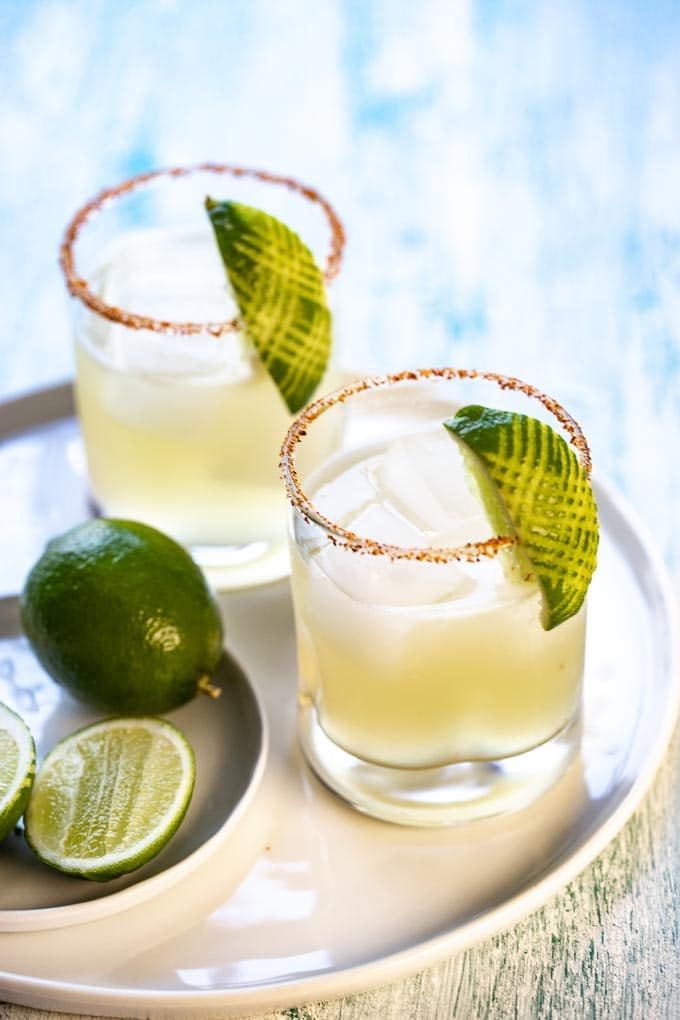 two glasses of a simple margarita recipe on a white tray.