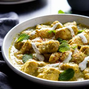 bowl with chicken korma on a napkin.